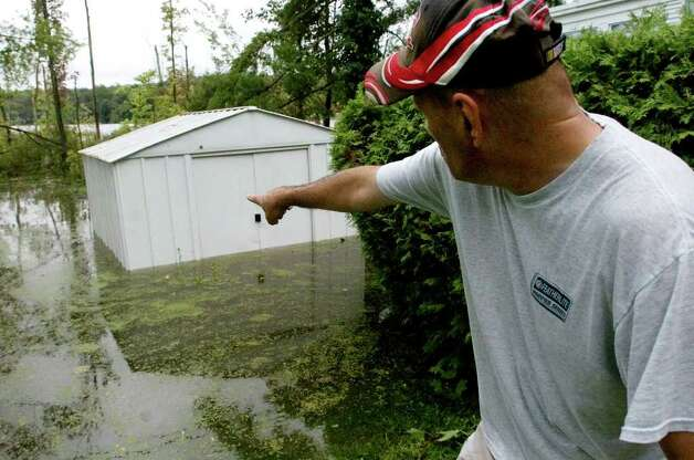Lenny Edwards, resident of Jensen's Lakeview mobile home community, shows the high the water reaching his shed due to Hurricane Irene in Danbury on Sunday, Aug. 28, 2011. Photo: Jason Rearick / The News-Times