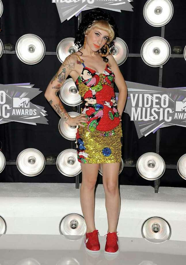 "Clearly, rapper (and ""Best New Artist"" nominee) Kreayshawn isn't wearing any Gucci, Louis, Fendi, or Prada. However, this Disney-inspired mess had many wishing she'd picked up some designer duds instead.  Photo: Jason Merritt, Getty Images / 2011 Getty Images"