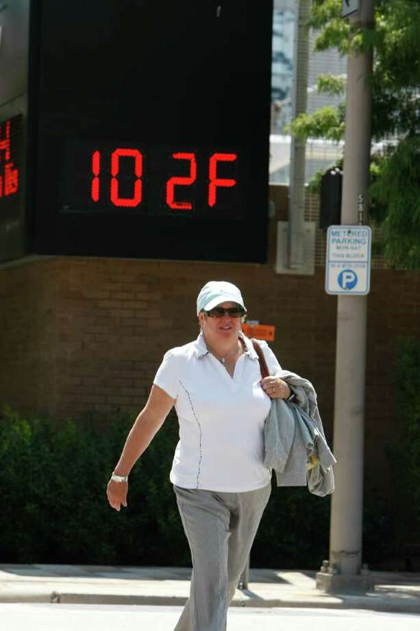 Jill Gardener, of Victoria, British Columbia, now has photographic proof of our heat wave for her friends back home. Photo: Johnny Hanson, Staff / © 2011 Houston Chronicle