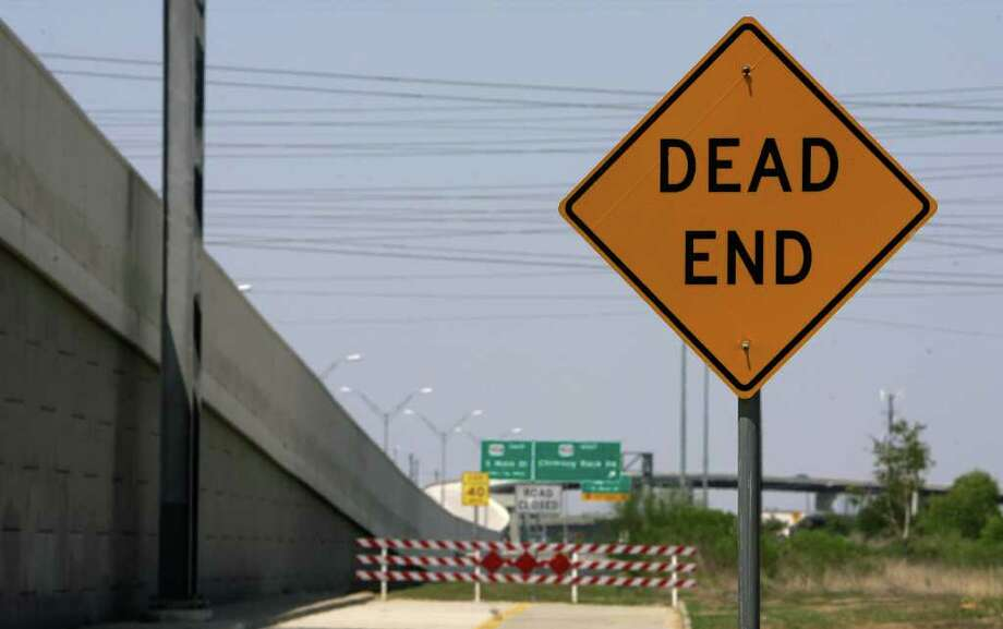 A dead end sign is seen leading into an unfinished feeder road into Fort Bend Parkway Sunday, Aug. 28, 2011, in Houston. The parkway was originally intended to connect to the 610 loop, but it ends at U.S. Route 90.  (Cody Duty / Houston Chronicle ) Photo: Cody Duty, Staff / © 2011 Houston Chronicle