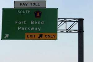 A Fort Bend Parkway sign is seen Sunday, Aug. 28, 2011, in Houston. The parkway was originally intended to connect to the 610 loop, but it ends at U.S. Route 90.  (Cody Duty / Houston Chronicle )