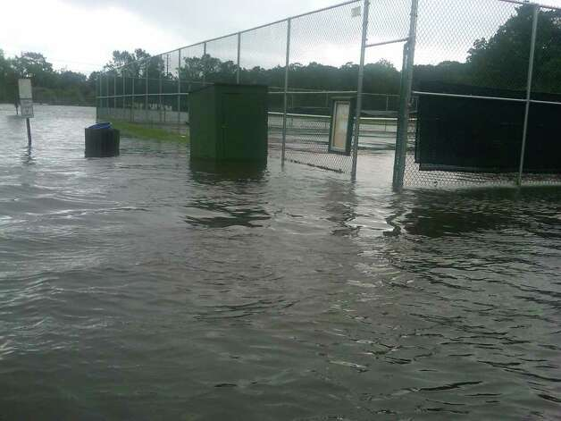 Tennis courts at Binney Park are flooded following Irene's landfall. Photo / Bob Horton Photo: Hearst Connecticut Media Group