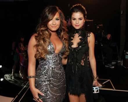 LOS ANGELES, CA - AUGUST 28:  Singer/actresses Demi Lovato (L) and Selena Gomez arrive at the 2011 MTV Video Music Awards at Nokia Theatre L.A. LIVE on August 28, 2011 in Los Angeles, California. Photo: Christopher Polk, Getty Images / 2011 Getty Images