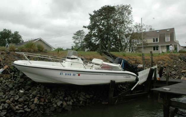 A boat washed up on the rocks along Pine Creek in Fairfield, Conn. as treacherous weather caused by Hurricane Irene came through the area on Sunday Aug. 28, 2011. Photo: Cathy Zuraw / Connecticut Post