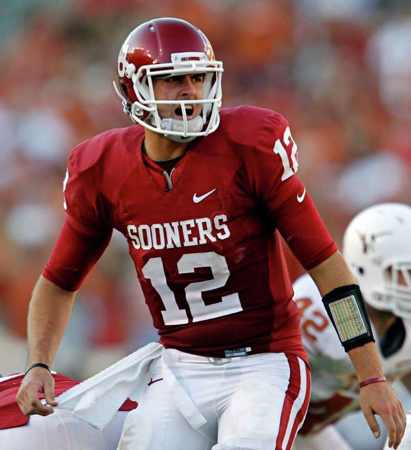 Oklahoma quarterback Landry Jones enters the season as a Heisman Trophy contender after throwing for 4,718 yards and 38 touchdowns in 2010. Photo: G.J. McCARTHY/Staff Photographer, ALL / 10005527A