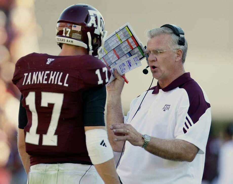 A&M head coach Mike Sherman, right, wants his team to have a day-by-day, game-by-game approach this season. Photo: Nick De La Torre, Houston Chronicle / Houston Chronicle