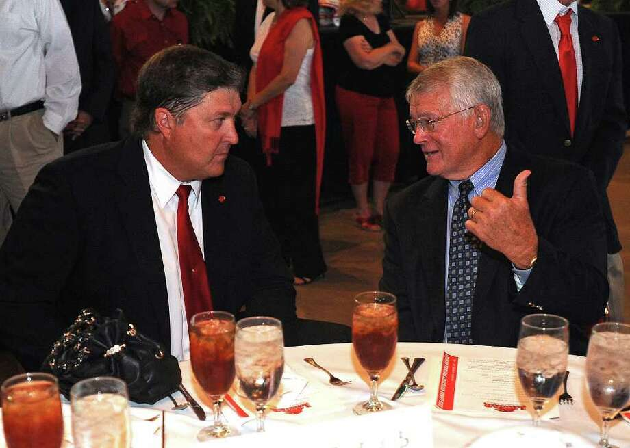 Lamar's Ray Woodard talks with former Dallas Cowboys player and assistant coach Dan Reeves at Sunday's football banquet. Guiseppe Barranco/The Enterprise