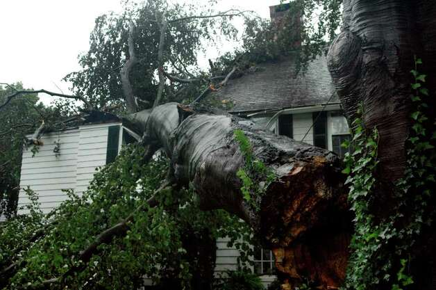 A house on Center Street in Southport, Conn. was damaged by a fallen tree during the treacherous weather caused by Hurricane Irene on Sunday Aug. 28, 2011. Photo: Cathy Zuraw / Connecticut Post