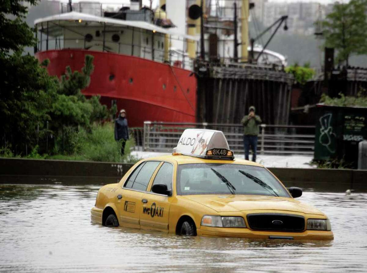 A New York City taxi is stranded in deep water on Manhattan?'s West Side as Tropical Storm Irene passes through the city, Sunday, Aug. 28, 2011 in New York. Although downgraded from a hurricane to a tropical storm, Irene?'s torrential rain couple with high winds and tides worked in concert to flood parts of the city. (AP Photo/Peter Morgan)