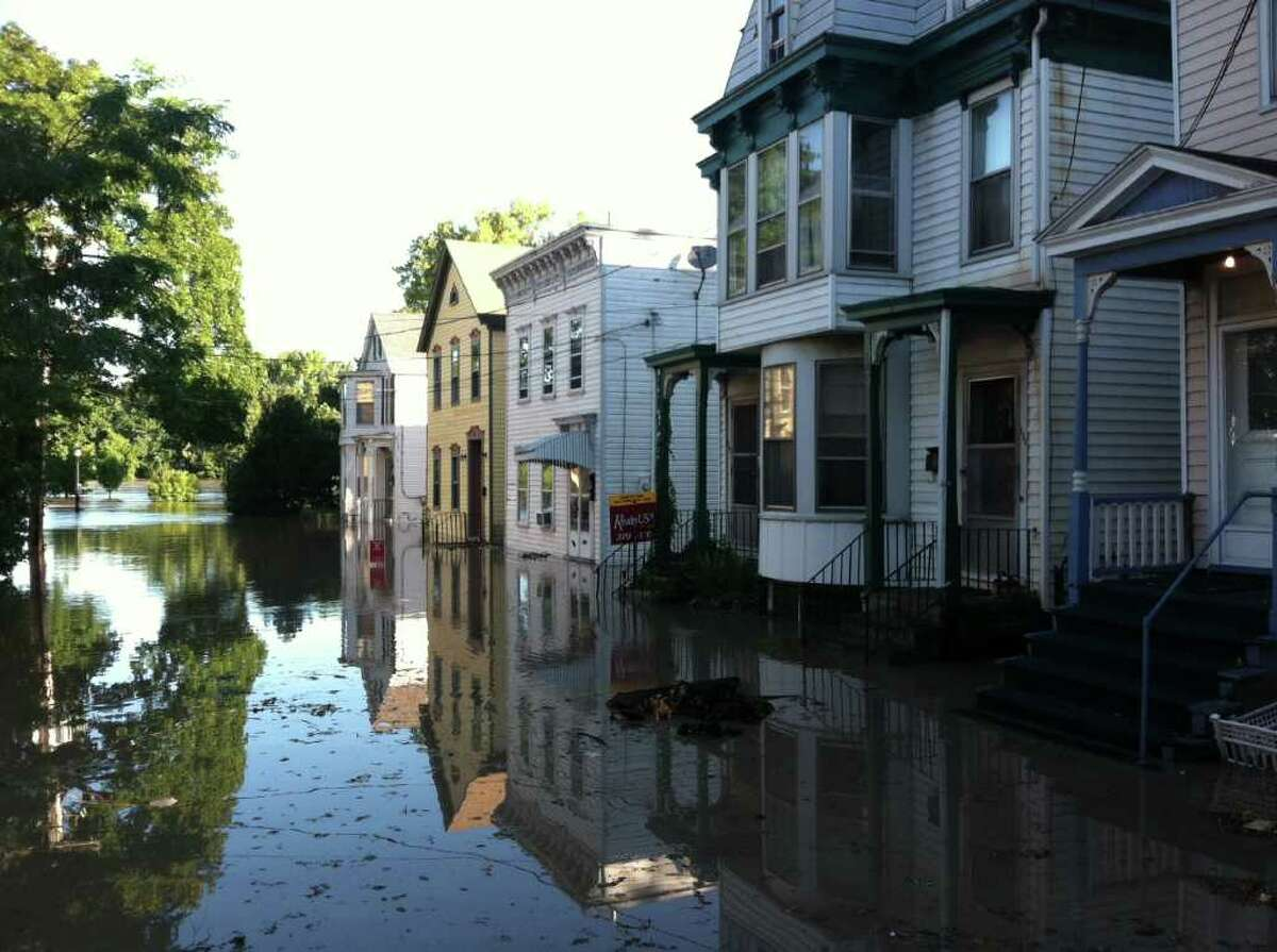 Homes are flooded along North Ferry Street in Schenectady's Stockade Monday morning. City officials initially feared flooding of historic proportions, but said Monday that the flooding might not be as bad as initially expected. (Skip Dickstein / Times Union)