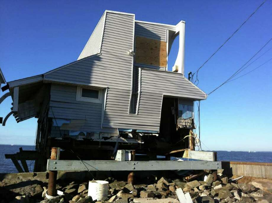 A house on Fairfield Beach Road in Fairfield, Conn. was in shambles on Monday, August 29, 2011 after winds from Hurricane Irene ripped through the Connecticut coastline a day earlier. Photo: Tom Cleary