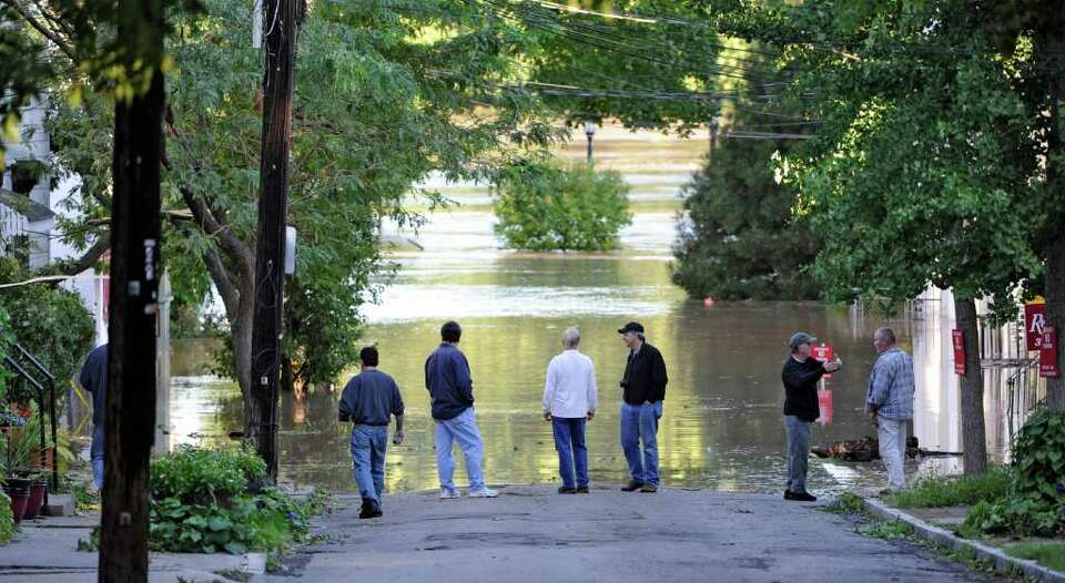 Residents of N. Ferry Street in the Stockade section of Schenectady, N.Y. watch as water rises from