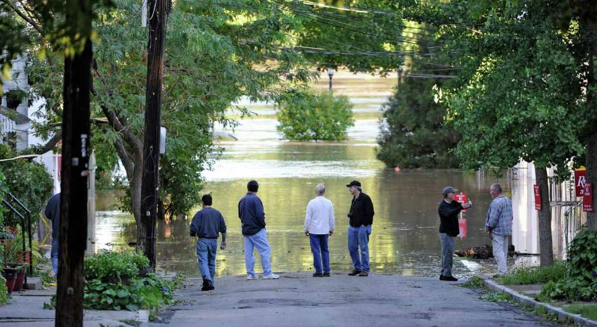 Residents of N. Ferry Street in the Stockade section of Schenectady, N.Y. watch as water rises from the Mohawk River and floods homes on the street. (Skip Dickstein / Times Union)