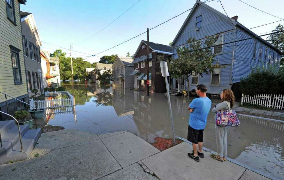 Ronnie and Estell Ivanella of 15 North Street in the Stockade section of Schenectady, N.Y. watch as water rises from the Mohawk River and floods homes on the street. (Skip Dickstein / Times Union)