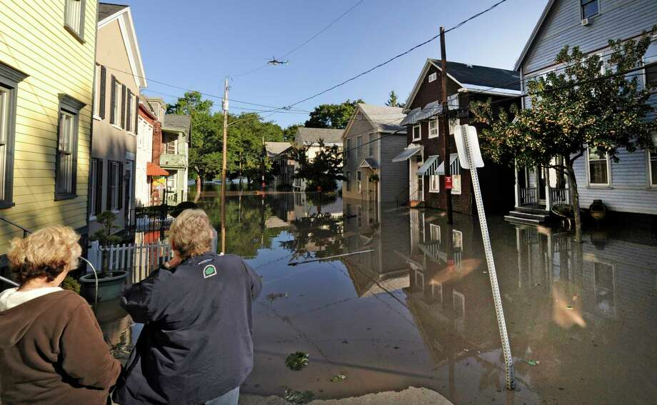 Residents of North Street in the Stockade section of Schenectady, N.Y. watch as water rises from the Mohawk River and floods homes on the street. (Skip Dickstein / Times Union) Photo: SKIP DICKSTEIN / 2011