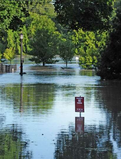 N. Ferry Street floods as water rises from the Mohawk River and floods homes on the street. (Skip Di