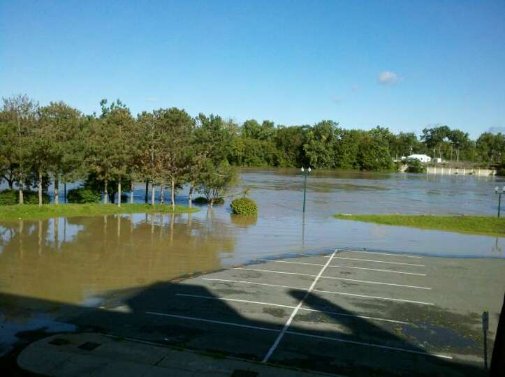 The Hudson River pours into Troy's Riverfront Park on Monday, Aug. 30, 2011, as runoff from Tropical