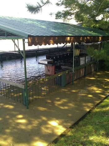 The patio at Dinosaur Bar-B-Que was inundated with flood waters as the Hudson River swelled into Troy on Monday, Aug. 29, 2011. (Eric Anderson / Times Union)
