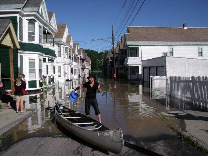 Patrick Bulletti canoed from his flooded home in Schenectady's Stockade on Monday, Aug. 29, 2011. (J