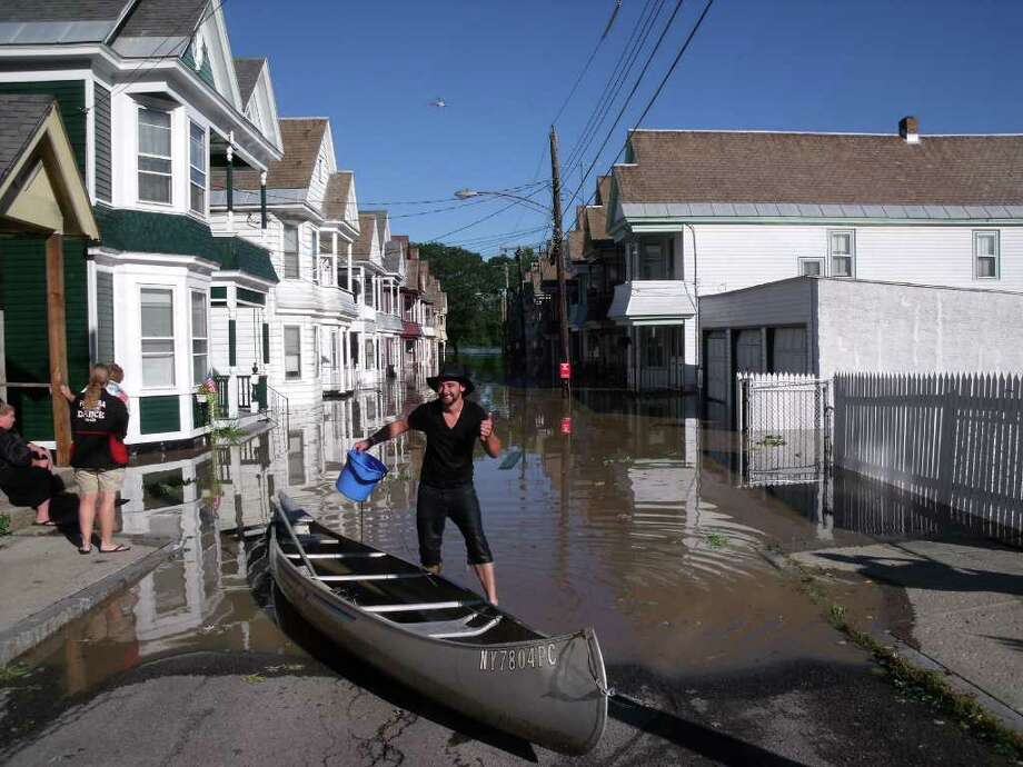 Patrick Bulletti canoed from his flooded home in Schenectady's Stockade on Monday, Aug. 29, 2011. (James M. Odato/Times Union)
