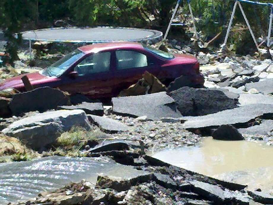 Destruction off Route 443 in New Scotland on Monday, Aug. 29, 2011, the day after Tropical Storm Irene devastated upstate New York with torrential rains. (JORDAN CARLEO-EVANGELIST / TIMES UNION)