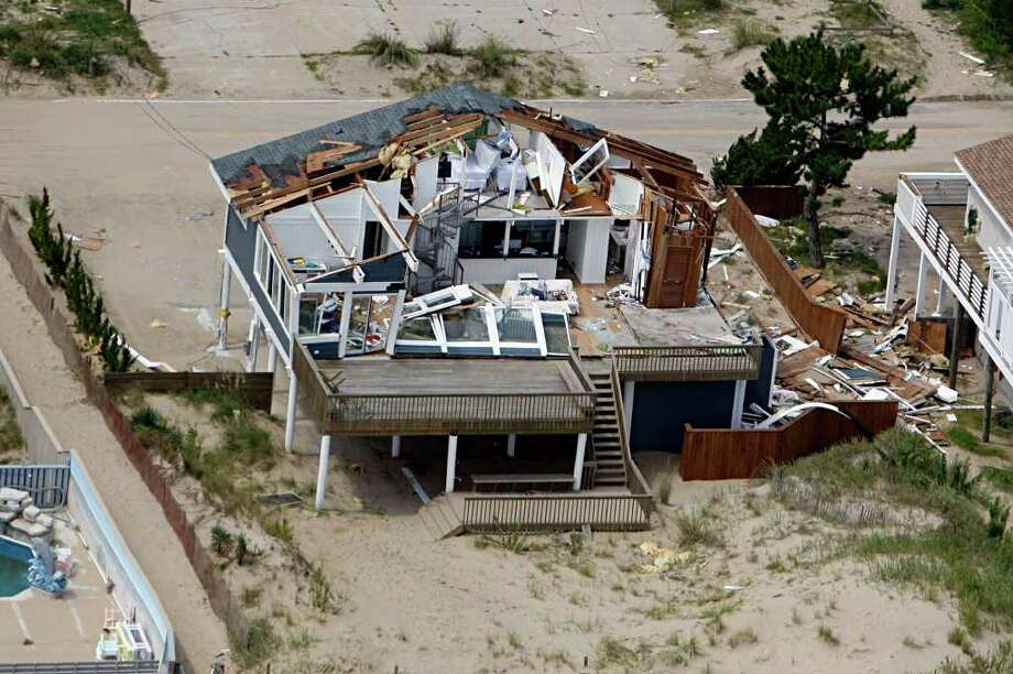 This aerial photo taken Sunday, Aug. 28, 2011 shows damage to a home in Virginia Beach, Va., after a reported tornado, spurned by Hurricane Irene, ripped through the area Saturday. Photo: AP