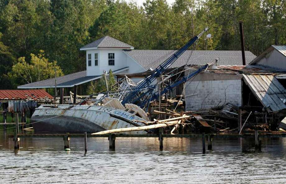 A shrimp boat is bashed against the dock of Daniel's Seafood at the shoreline of the Pamilco River near Aurora, N.C., Sunday, Aug. 28, 2011 after Hurricane Irene hit the North Carolina coast. Photo: AP
