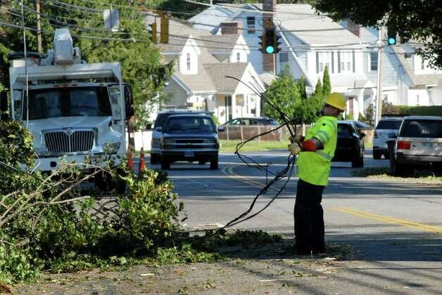 A crew from Sumter Utilities in South Carolina works on repairing a downed wire on Shippan Ave in Stamford, Conn. on Monday August 29, 2011, cleaning up after tropical storm Irene. Photo: Dru Nadler / Stamford Advocate Freelance