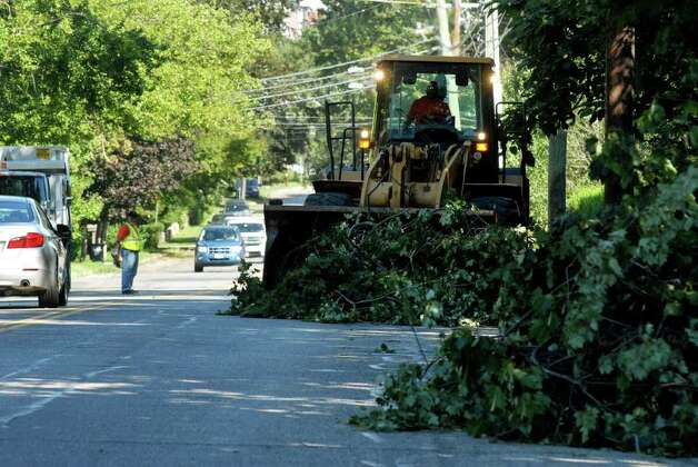 City of Stamford, Conn. workers clean up Shippan Ave on Monday August 29, 2011 after tropical storm Irene. Photo: Dru Nadler / Stamford Advocate Freelance