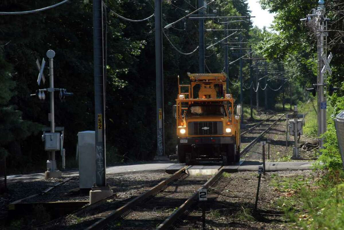 A Metro North truck checks for damage on the tracks on the New Canaan line near Springdale station in Stamford, Conn. on Monday August 29, 2011 after tropical storm Irene.