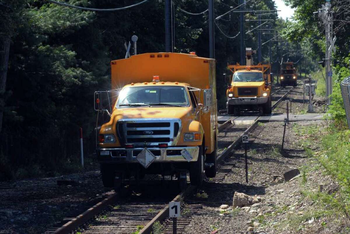 Metro North trucks check the New Canaan line near the Springdale station in Stamford, Conn. for problems on the track on Monday August 29, 2011 after tropical storm Irene.