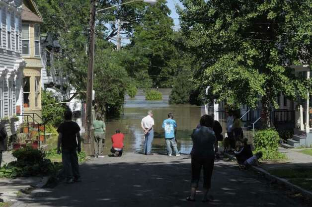 People come out to looking over flooding on North Ferry St. in the Stockade section of Schenectady as the Mohawk River overflowed its banks flooding homes in this section of the city on Monday, Aug. 29, 2011. (Paul Buckowski / Times Union) Photo: Paul Buckowski  / 00014438B