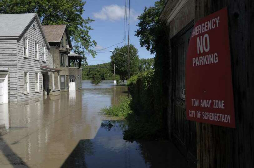 A section of Governor's Lane is flooded in the Stockade section of Schenectady as the Mohawk River o