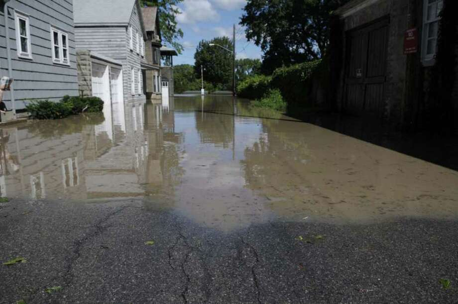 Flood waters continued to creep forward up Governor's Lane in the Stockade section of Schenectady as the Mohawk River overflowed its banks flooding homes in this section of the city on Monday, Aug. 29, 2011. (Paul Buckowski / Times Union) Photo: Paul Buckowski  / 00014438B