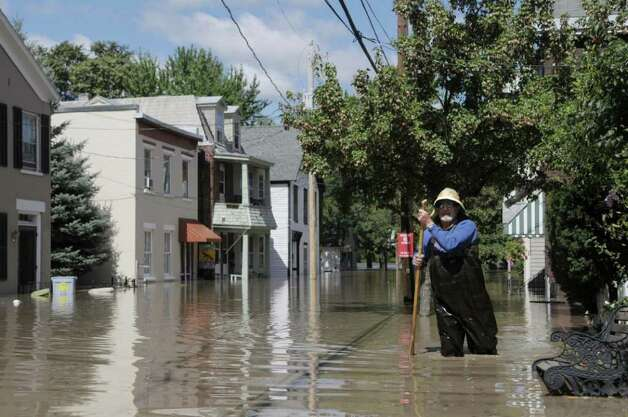 Jim Duggan makes his way back up North St. after checking on his home in the Stockade section of Schenectady as the Mohawk River overflowed its banks flooding homes in this section of the city on Monday, Aug. 29, 2011.   Duggan has lived on the street since 1965 and said that he stays there even after numerous floods through the years because of the neighborhood and the people.  (Paul Buckowski / Times Union) Photo: Paul Buckowski  / 00014438B