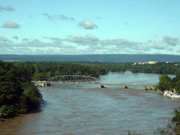 A view from River Rd. looking over the Rexford Bridge and the swollen Mohawk River on Monday, Aug. 29, 2011. (Paul Buckowski / Times Union) Photo: Paul Buckowski  / 00014438B