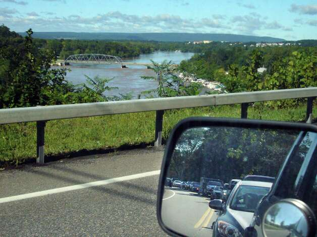 Traffic is backed up on River Rd. as drivers try to make their way to the Rexford Bridge, seen in the background, and over the swollen Mohawk River on Monday, Aug. 29, 2011.   The Freemans Bridge had been shut down due to flooding and so many drivers had to use the Rexford Bridge to get into Schenectady.  (Paul Buckowski / Times Union) Photo: Paul Buckowski  / 00014438B