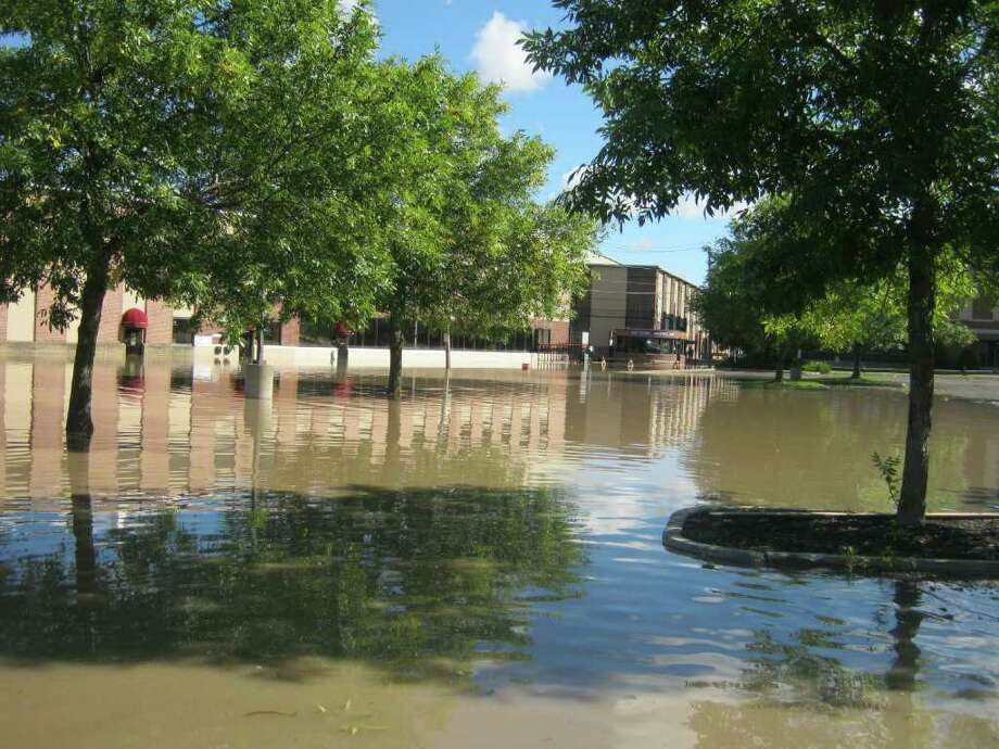 Water rises in the Stockade neighborhood Monday morning.