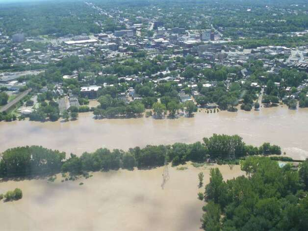 Schenectady's Stockade as seen from a plane is swamped with floodwaters from the Mohawk River on Monday, Aug. 28, 2011, a day after Tropical Storm Irene poured water on upstate New York. (JIMMY VIELKIND / TIMES UNION)