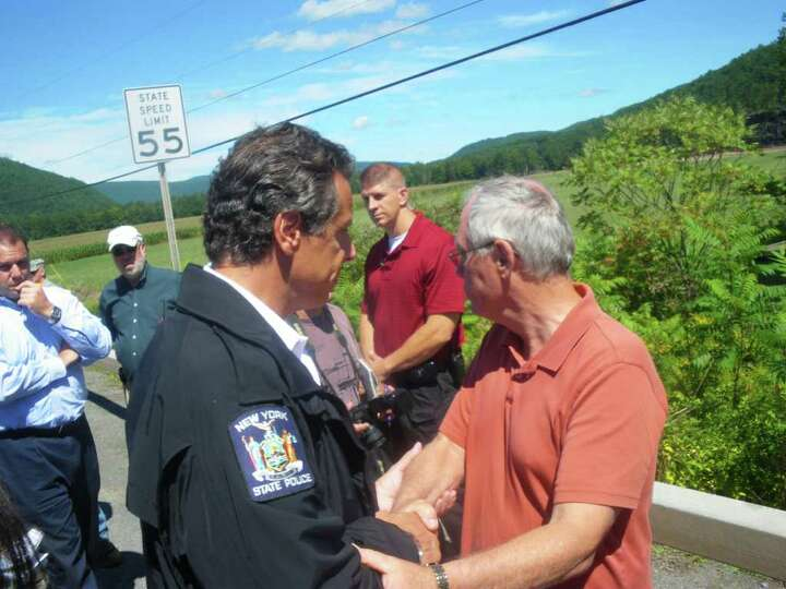 Gov. Andrew Cuomo talks with Dennis Richards, supervisor of the Town of Middleburgh, Schoharie Count