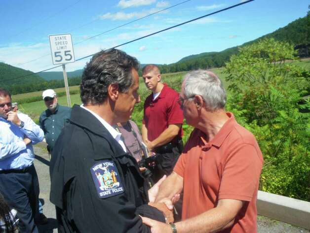 Gov. Andrew Cuomo talks with Dennis Richards, supervisor of the Town of Middleburgh, Schoharie County on Monday, Aug. 28, 2011, the day after floodwaters from Tropical Storm Irene flooded upstate. (JIMMY VIELKIND / TIMES UNION)