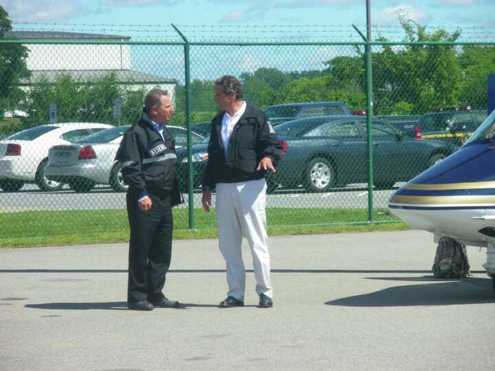 Gov. Andrew Cuomo speaks with State Operations Director Howard Glaser on Monday, Aug. 29, 2011. (JIM
