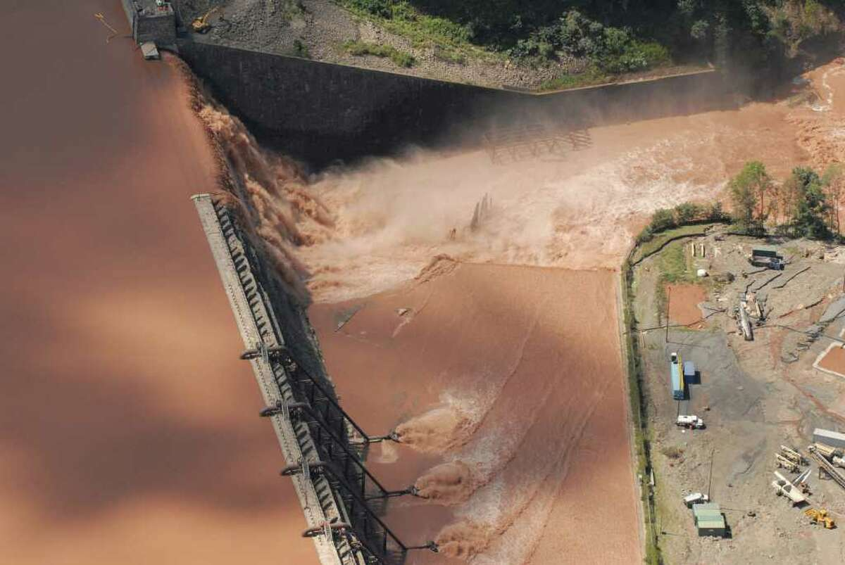 Click through the slideshow to see aerial photos of flooding in the Capital Region after Tropical Storm Irene. Water from the Schoharie Reservoir spills over the Gilboa Dam in Gilboa N.Y. Monday Aug. 29, 2011. (Will Waldron / Times Union)