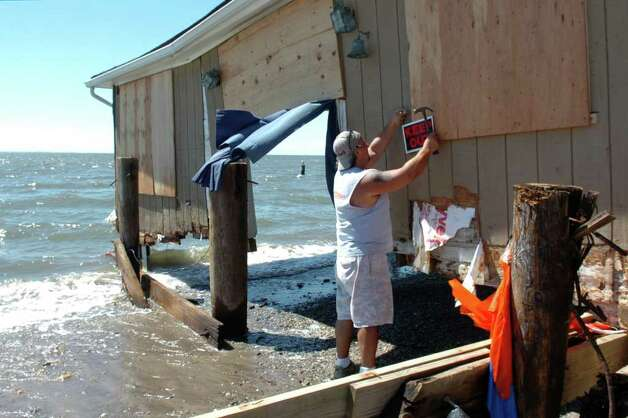 "Anthony Versace posts a ""Keep Out"" sign on the remains of his beach house in the Lordship section of Stratford, Conn. Aug. 29th, 2011. Sunday's storm surge raised the house off of its moorings and swept many of Versace's possessions away. Photo: Ned Gerard"
