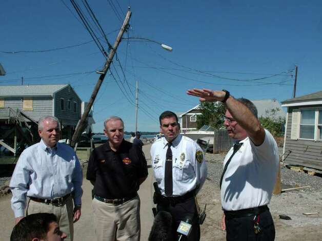 Fairfield First Selectman Michael Tetreau, Fire Chief Richard Felner, Police Chief Gary MacNamara and Assistant Fire Chief Douglas Chavenello hold a press conference at the far end of Fairfield Beach Road in Fairfield, Conn. Several homes were determined to be unsafe by the Town of Fairfield building officials on Monday Aug. 29, 2011 in Fairfield, Conn. on Monday Aug. 29, 2011. Photo: Cathy Zuraw / Connecticut Post