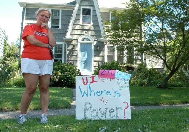 Puzzeled that most of her neighbors have electricty, Donna Ertel put a sign with a message to UI in the yard of her South Benson Road home in Fairfield, Conn. on Monday Aug. 29, 2011. Ertel intends to update it every 12 hours until power is restored. Photo: Cathy Zuraw / Connecticut Post