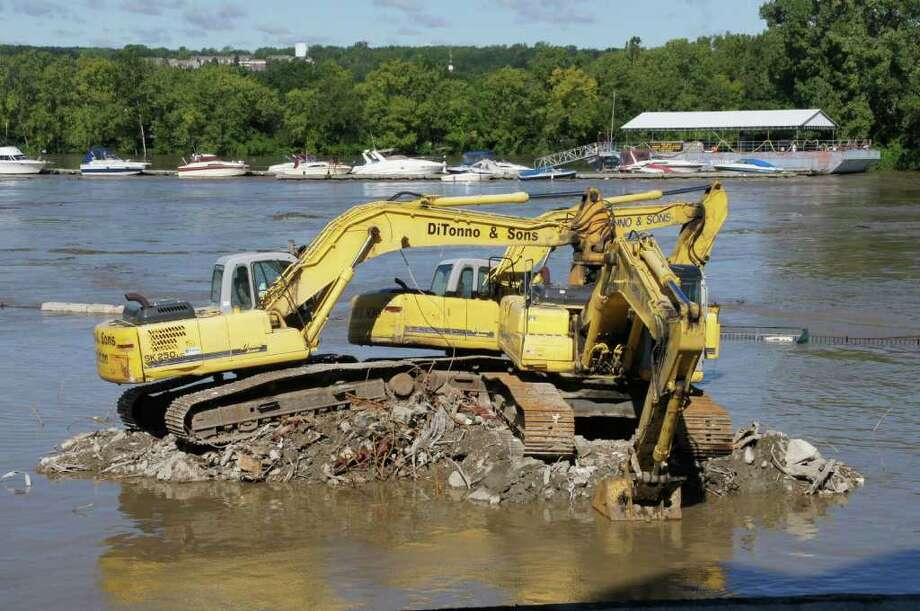 Machines used to knock down and clean up Troy's City Hall sit surrounded by water on Monday morning. Photo: Picasa, .