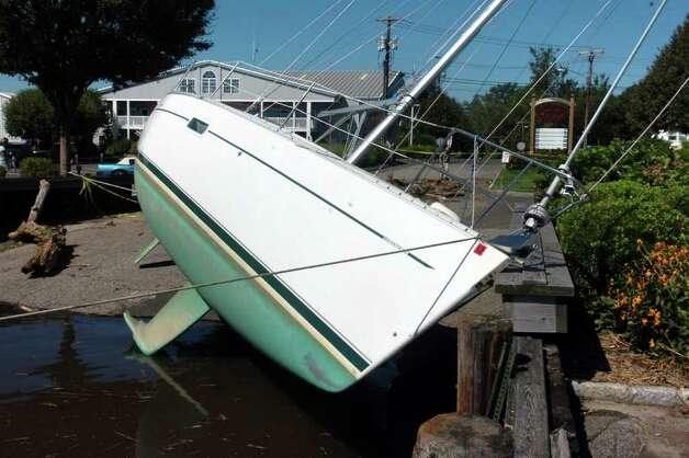 The sailboat At Last 2 at Stratford Marina, in Stratford, Conn. Aug. 29th, 2011, where is wash ashore during Sunday's storm. Photo: Ned Gerard