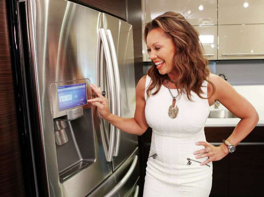 The new Samsung LCD refrigerator with apps allows you to keep track of Twitter and look at your Google Calendar. The company hired Vanessa Williams of Desperate Housewives and mother of four to be it's number one tester. Photo: Samsung, Samsung Fridge Vanessa Williams / Samsung