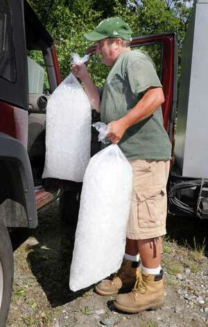 Michael Aurelia of Newtown, loads up with ice at The Ice House in Danbury. His home is out of power as a result of Tropical Storm Irene Sunday. Photo taken Monday, Aug. 29, 2011. Photo: Carol Kaliff